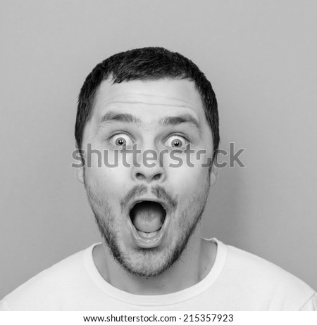 Portrait of man with funny face - Monochrome or black and white portrait - stock photo