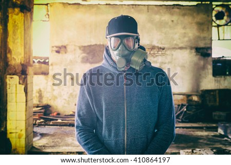 Portrait of man with gas mask on his face,selective focus  - stock photo