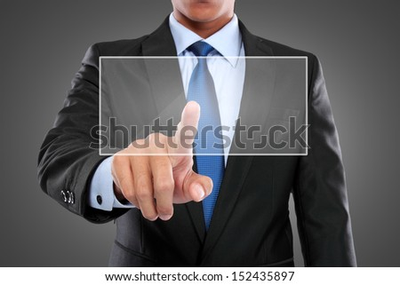 Portrait of man with hand pushing on a touch screen interface. ready for your design - stock photo
