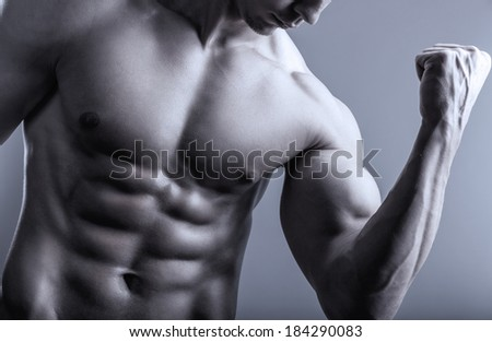 Portrait of man with muscular arms - stock photo