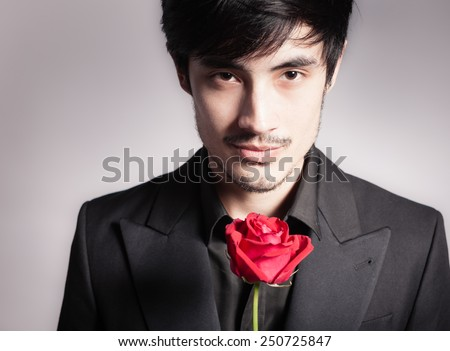 Portrait of man with rose. Love concept - stock photo