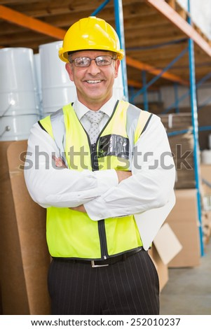 Portrait of manager wearing hard hat in the warehouse - stock photo