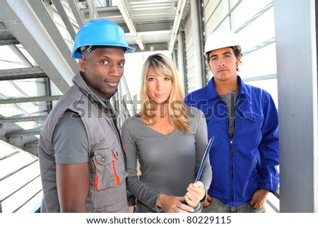Portrait of manager with storage people - stock photo