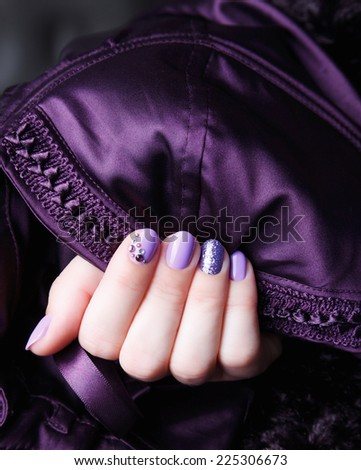 Portrait of manicured and painted nails - stock photo