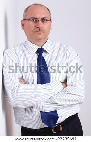 Portrait of mature businessman in shirt and blue necktie - stock photo