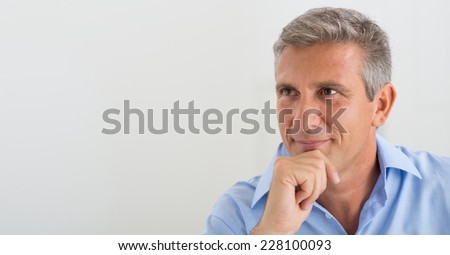 Portrait Of Mature Businessman Thinking About The Project - stock photo