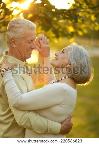 Portrait of Mature couple in the autumn park - stock photo