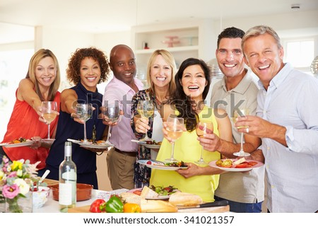 Portrait Of Mature Friends Enjoying Dinner Party At Home - stock photo