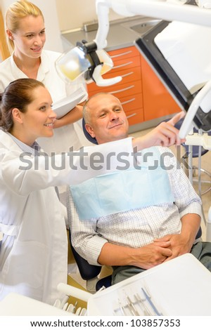 Portrait of mature man consultation with dentist surgeon stomatology clinic - stock photo