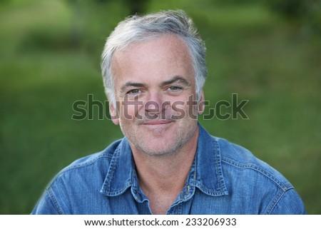 Portrait of mature man outdoors - stock photo