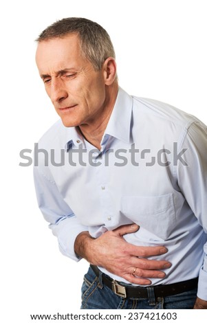 Portrait of mature man suffering from stomachache. - stock photo