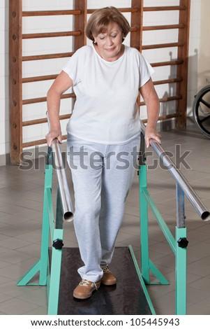 Portrait of mature woman having ambulatory therapy. - stock photo