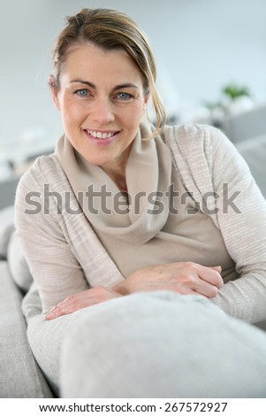 Portrait of mature woman relaxing in sofa - stock photo