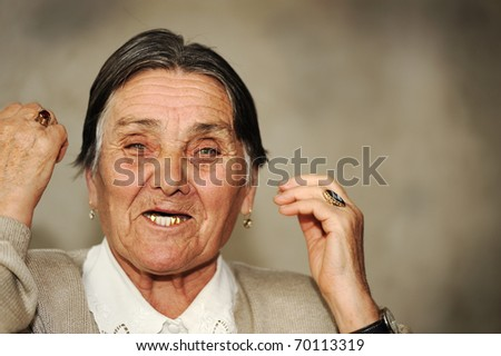 Portrait of mature woman speaking with expressions, grimaces and gestures - stock photo