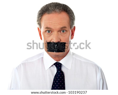 Portrait of matured businessman with duct tape on his mouth - stock photo