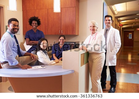 Portrait Of Medical Staff At Nurse's Station In Hospital - stock photo