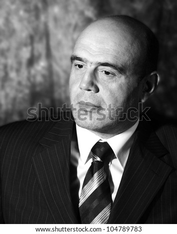 Portrait of men in low key in black and white - stock photo