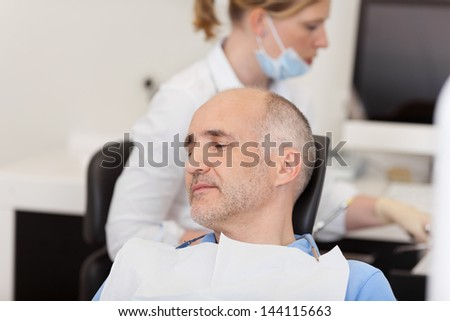 Portrait of mid adult male patient in dentistry - stock photo