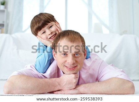 Portrait of mid adult man and his little son - stock photo