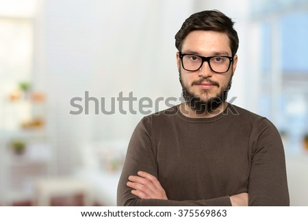 Portrait of mid adult man in glasses - stock photo