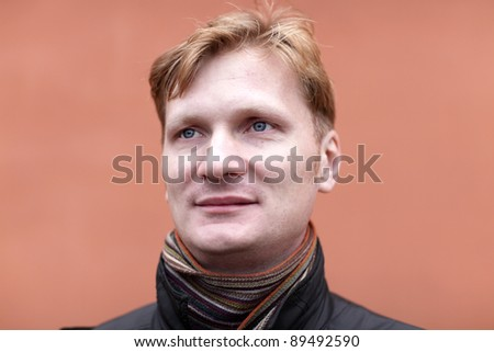 Portrait of mid adult man on the red background - stock photo