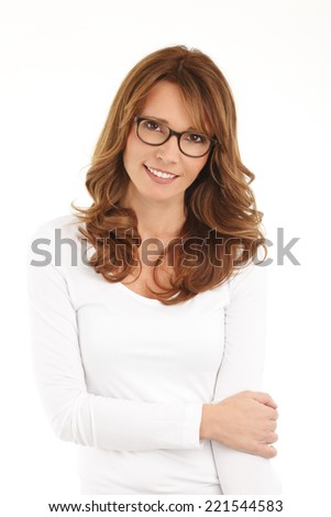 Portrait of middle age businesswoman standing against white background. - stock photo