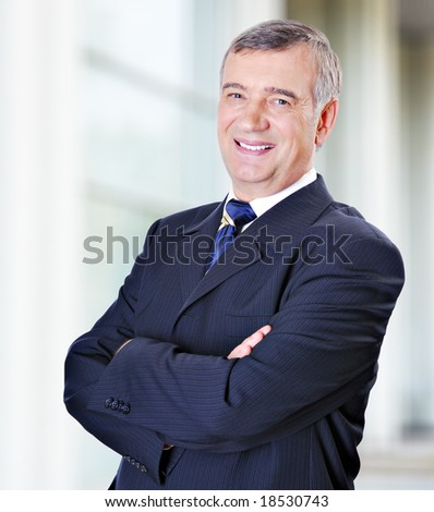 Portrait of middle-aged businessman in suit - stock photo