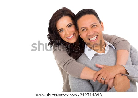 portrait of middle aged couple on white background - stock photo