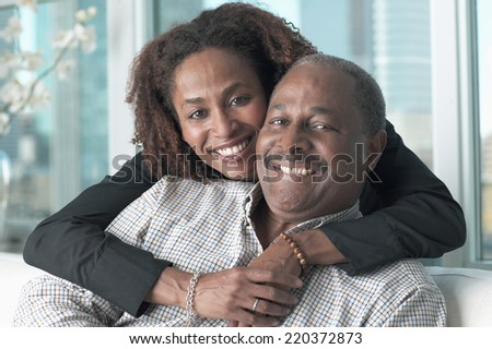 Portrait of middle-aged couple smiling - stock photo