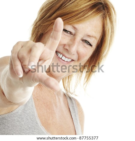 portrait of middle aged woman doing good symbol over white - stock photo