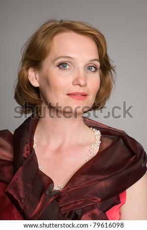 Portrait of middle aged woman in the red. - stock photo