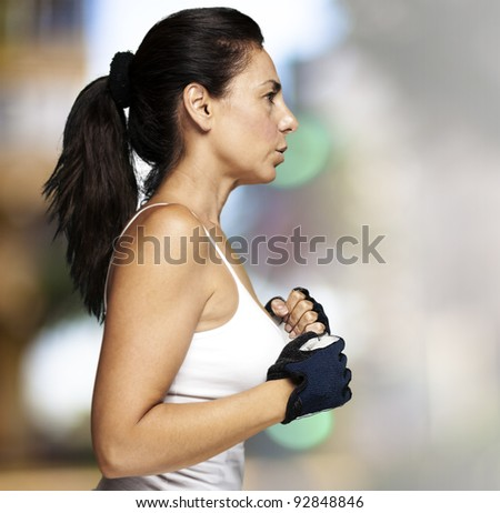 portrait of middle aged woman running against a city background - stock photo
