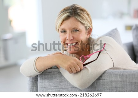 Portrait of middle-aged woman with eyeglasses - stock photo