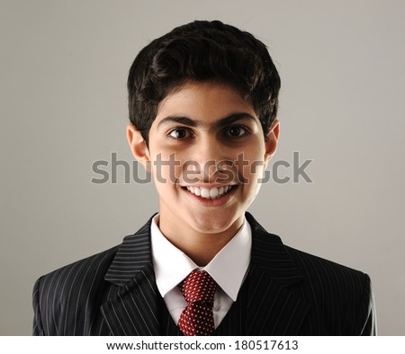 Portrait of Middle eastern boy wearing suit and tie - stock photo