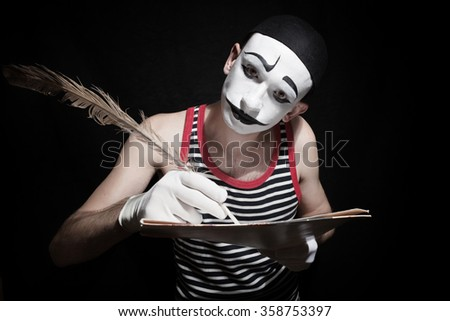 Portrait of  mime with  quill on black background - stock photo