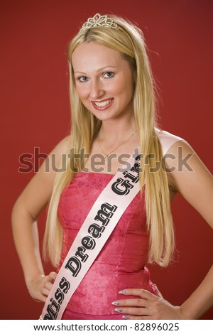 Portrait of miss dream girl over red background - stock photo