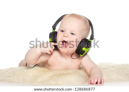 Portrait of 6 month old boy with headphones, isolated on white - stock photo