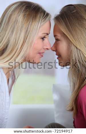 Portrait of mother and daughter -profile view - stock photo