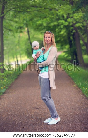 portrait of mother and her beautiful baby boy - stock photo