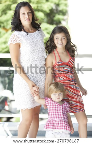 Portrait of mother and two young cute daughters  - stock photo