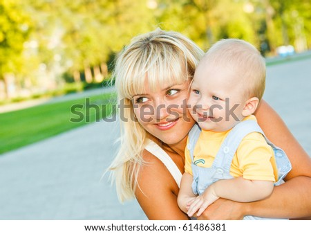Portrait of mother embracing son - stock photo