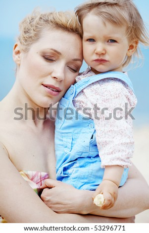 Portrait of mother holding her lovely child - stock photo