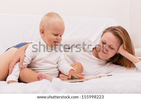 portrait of mother with baby  - stock photo