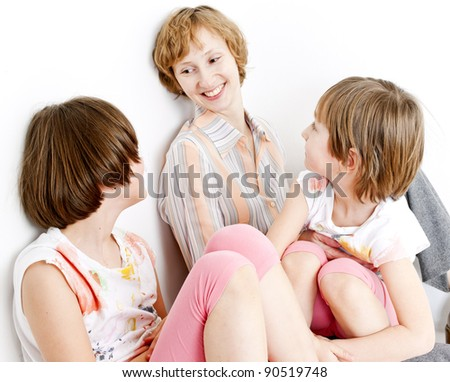 portrait of mother with their daughters - stock photo