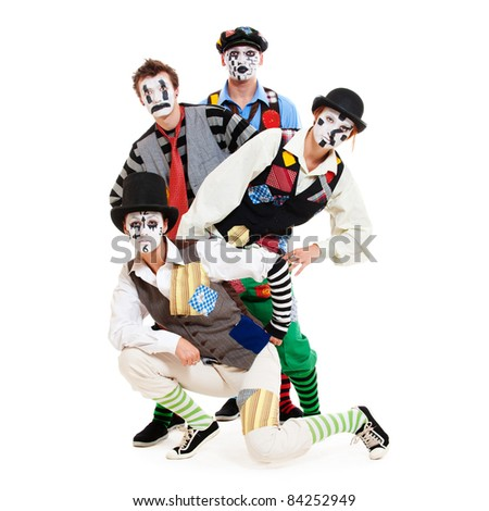 portrait of motley mimes. isolated on white background - stock photo