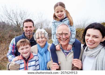 Portrait Of Multi Generation Family On Countryside Walk - stock photo