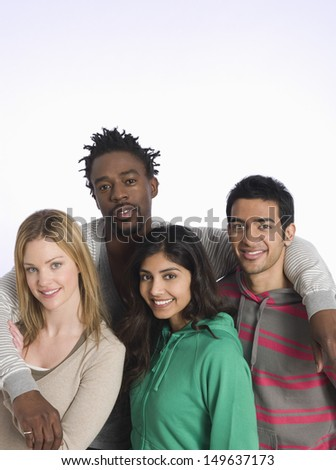 Portrait of multiethnic young people against white background - stock photo