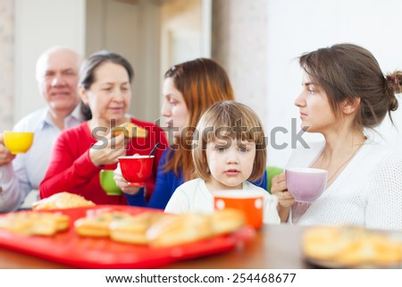 Portrait of multigeneration family having breakfast at home together - stock photo