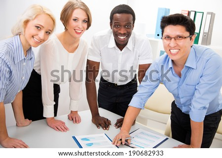 Portrait of multiracial business team in office - stock photo