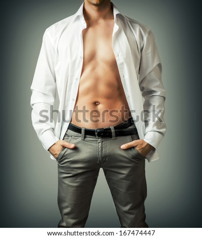 Portrait of muscle man torso in white shirt on grey background - stock photo